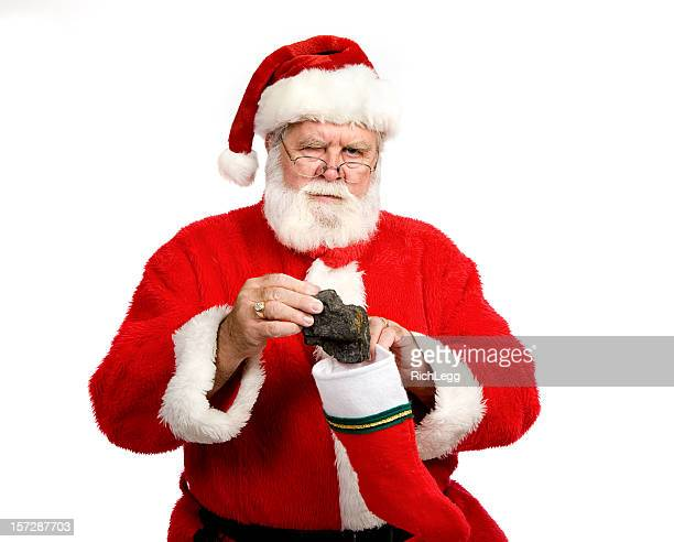 lump of coal - naughty santa stock photos and pictures
