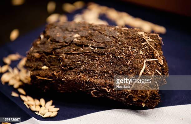 Lump of organic turf or peat used to make whiskey
