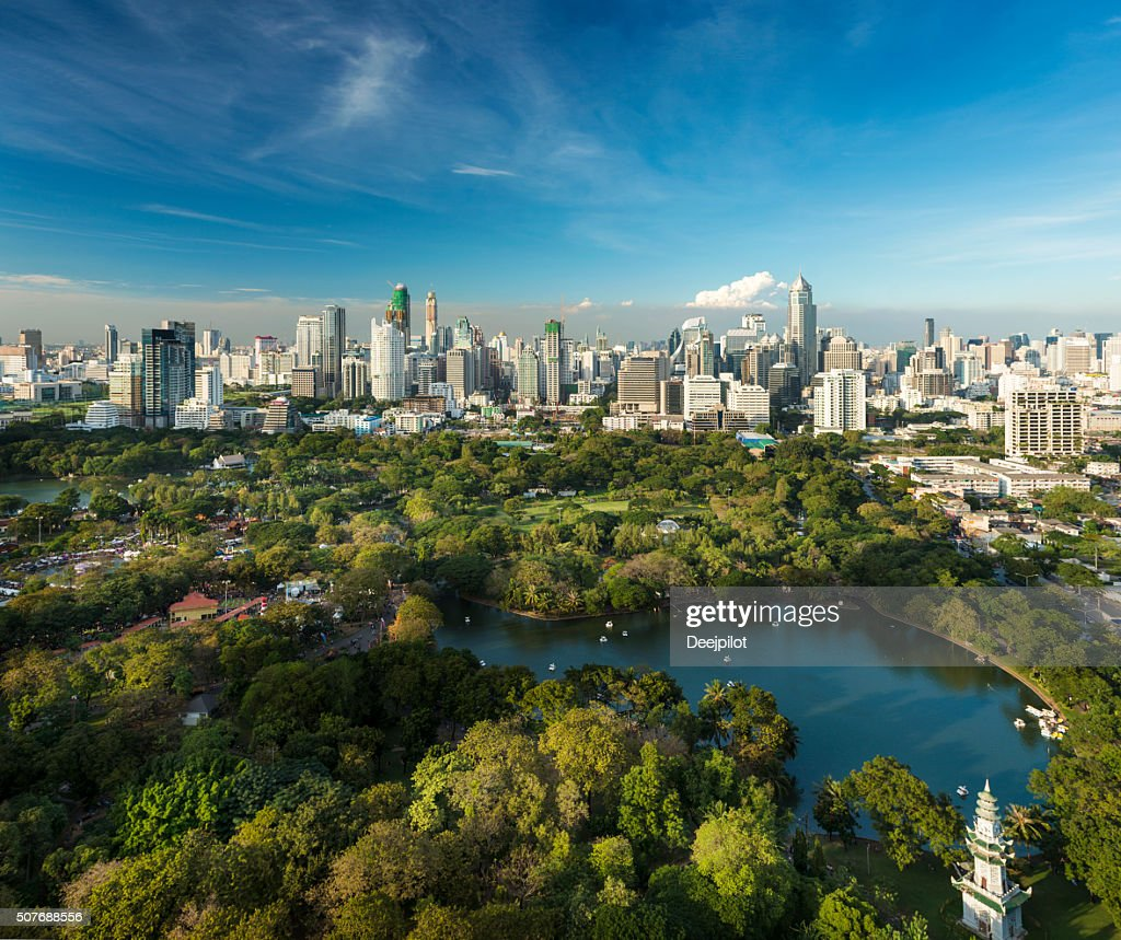 Lumphini Park and the downtown Bangkok City Skyline Thailand : Stock Photo