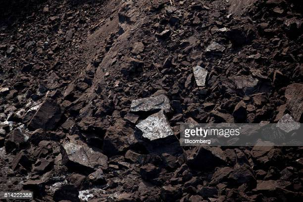 Lumps of brown coal sit after excavation at the Garzweiler open cast lignite mine operated by RWE AG in Garzweiler Germany on Thursday July 13 2017...