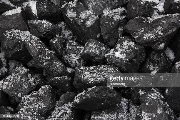 Lumps of coal sit in storage before shipping at the Sibirginsky open pit coal mine operated by OAO Mechel Mining a unit of OAO Mechel near Myski...