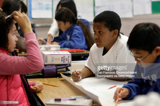 Lumumba Diop works on a group geometry project in 6th grad Math with Eric Yang , 11 and Maira Monasterio at A.P. Giannini Middle School in San...