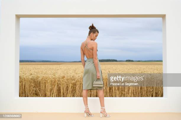 "Luna Bijl poses on the first line prior to ""L'Amour"" : Jacquemus Spring-Summer 2021 show on July 16, 2020 in Paris, France."