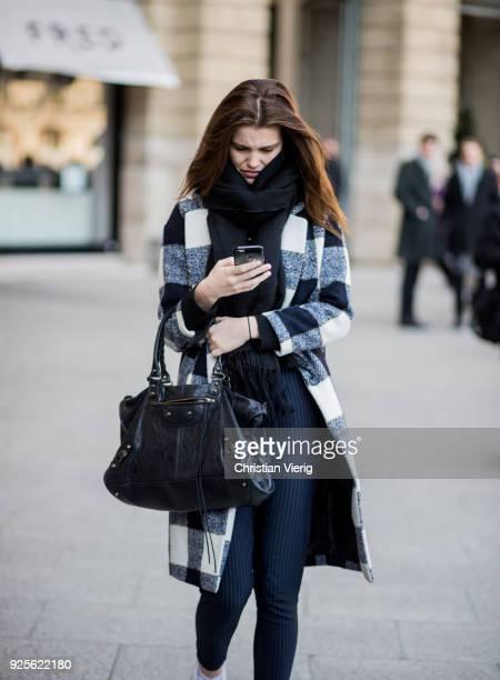 Luna Bijl wearing plaid wool coat is seen outside Lanvin on February 28 2018 in Paris France