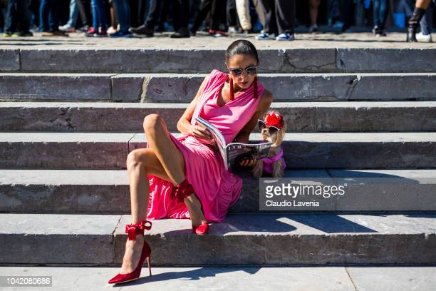 Luna De Casanova and Little Lola Sunshine the dog, wearing a pink dress and sunglasses, are seen after the Paco Rabanne show on September 27, 2018 in...