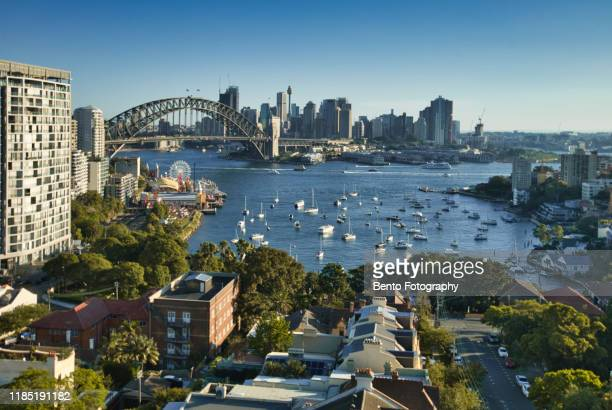 luna park and harbour bridge in sunset from north sydney, sydney, australia - luna park sydney stock pictures, royalty-free photos & images