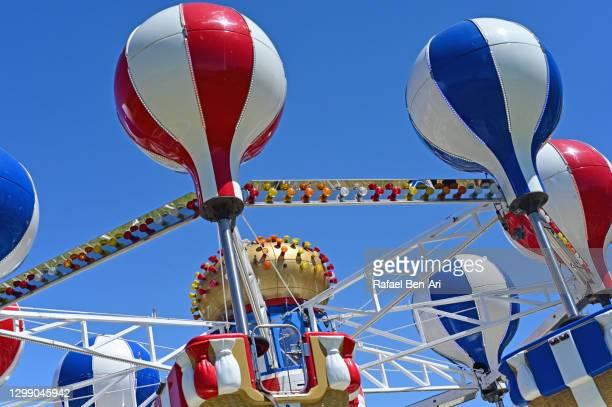 luna park spinning swing carousel - rafael ben ari ストックフォトと画像