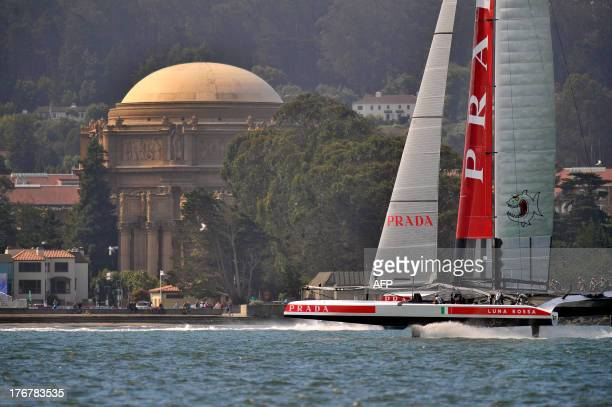Luna Rossa Challenge sails by the Palace of Fine Arts in San Francisco California on August 18 2013 AFP PHOTO/Josh Edelson