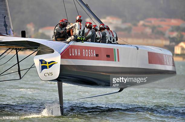Luna Rossa Challenge sails during a practice run in San Francisco California on August 18 2013 AFP PHOTO/Josh Edelson