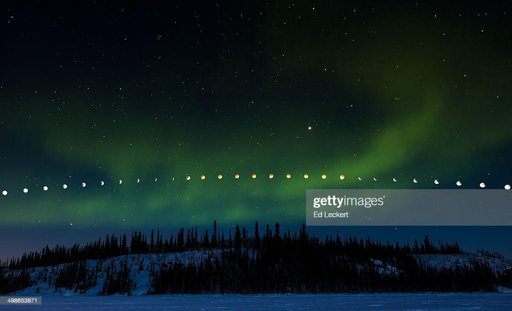 Lunar Eclipse and Aurora Borealis : Stock Photo