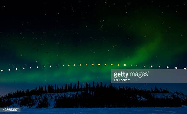 lunar eclipse and aurora borealis - leckert stock pictures, royalty-free photos & images