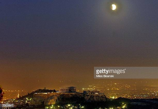 Lunar eclipse seen over the Parthenon the ancient temple to Athena on May 16 2003 in Athens Greece