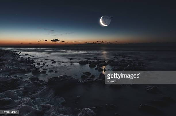 lunar gravity - tide stock pictures, royalty-free photos & images