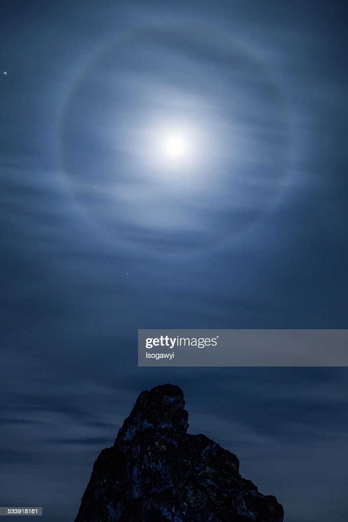 A Lunar Halo Above The Rocks : ストックフォト
