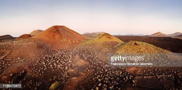 lunar landscape at sunset in lanzarote, canary islands. aerial view panorama - francesco riccardo iacomino spain foto e immagini stock