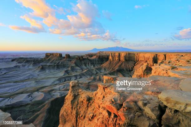 lunar landscape with cliffs illuminated by the rising sun in a desert landscape - rainer grosskopf stock pictures, royalty-free photos & images