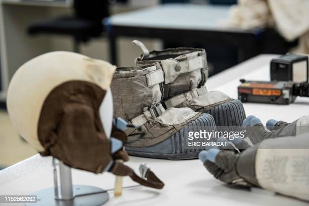 Buzz Aldrin's Snoopy cap Neil Armstrong's gloves and Gene Cernan's boots are is seen inside the Conservation Laboratory of the Air and Space Museum...