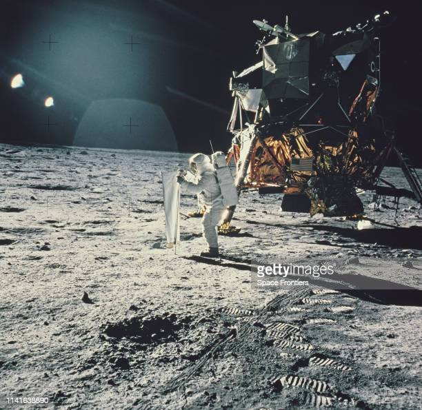 Lunar Module Pilot Edwin 'Buzz' Aldrin sets up the Solar Wind Composition experiment part of the Early Apollo Scientific Experiments Package at...