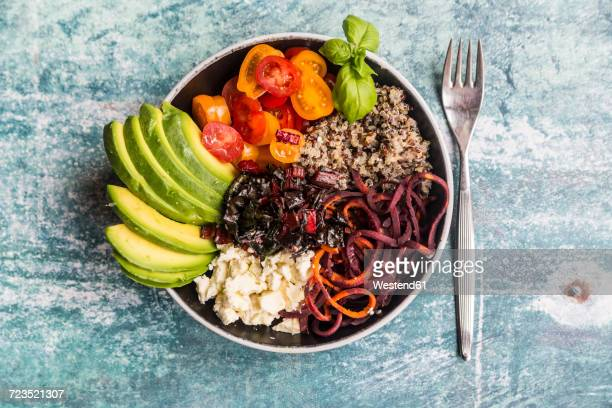 lunch bowl of quinoa tricolore, chard, avocado, carrot spaghetti, tomatoes and feta - vegetarian food stock pictures, royalty-free photos & images