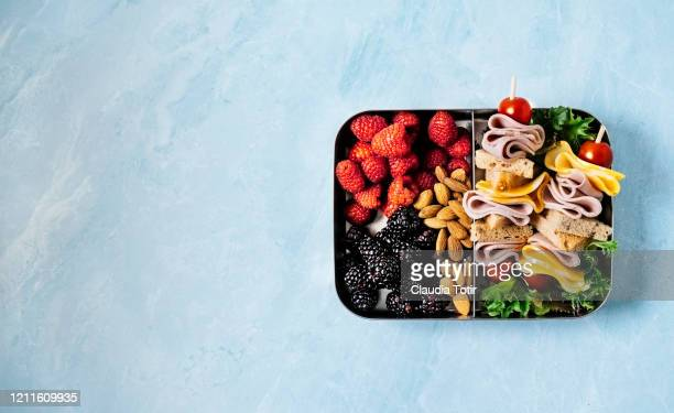 lunch box on blue background - lunch box stock pictures, royalty-free photos & images
