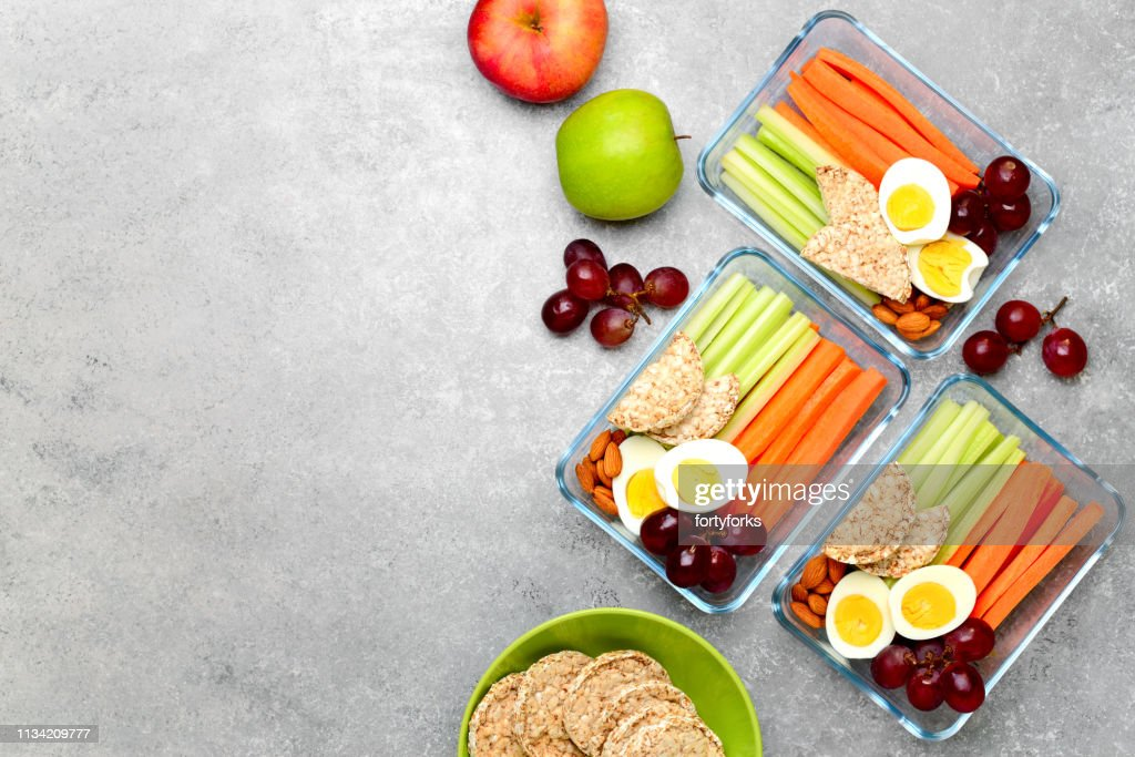Lunch boxes with healthy snacks, overhead view : Stock Photo