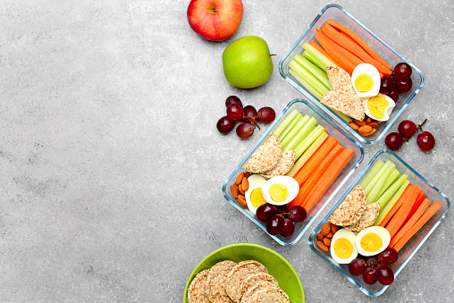Lunch boxes with healthy snacks, overhead view 1134209777