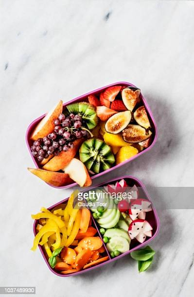 Lunch boxes with vegetables and fruits