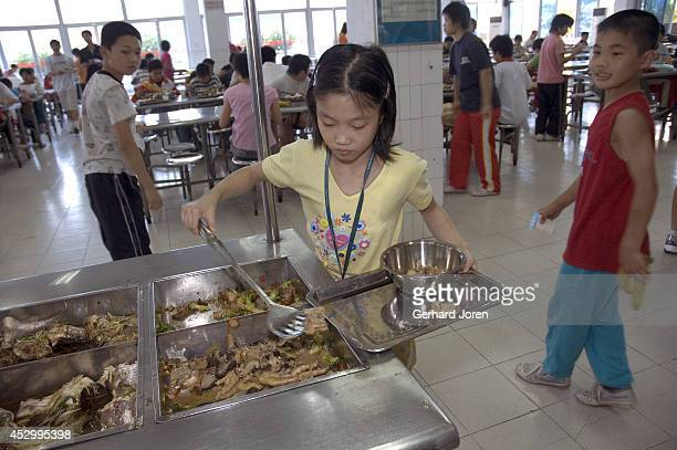 Lunch break at the Wei Lun Sports and Athletics School Established in the mid 50s the school was renovated in 1995 at a cost of US$ 25 million Nine...