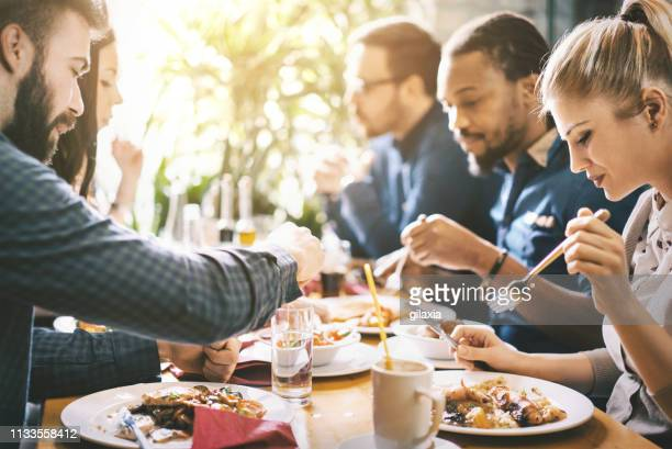 lunch break in a restaurant. - lunch break stock pictures, royalty-free photos & images