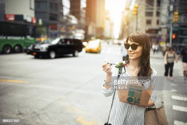 lunch break outdoors - mid adult women stock pictures, royalty-free photos & images