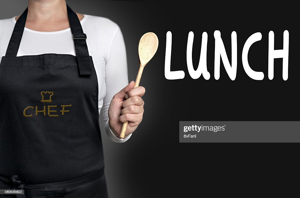 Lunch cook holding wooden spoon background : Stock Photo