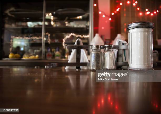 lunch counter at an american diner - diner stock pictures, royalty-free photos & images