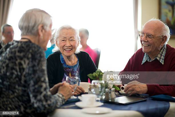 lunch in a nursing home - senior lunch stock photos and pictures