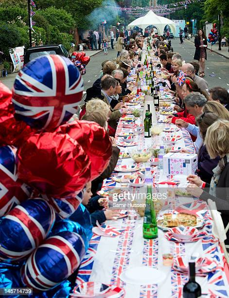 Lunch is enjoyed at a street party in Kensington during the Queen's Diamond Jubilee celebrations on June 4 2012 in London England For only the second...