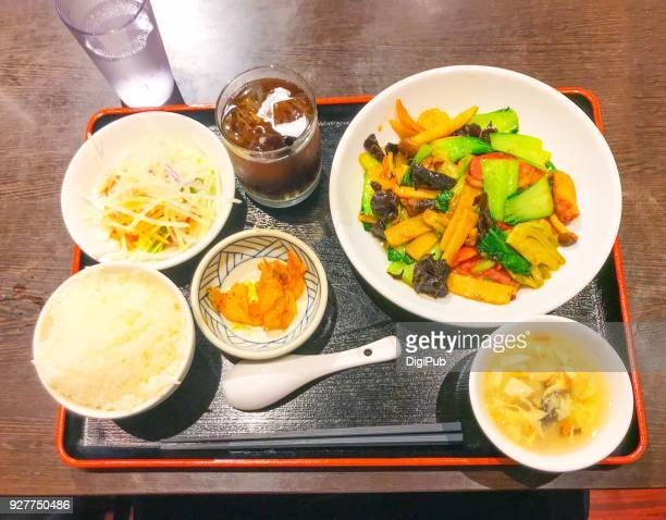 lunch meal of smock duck meat stir fried with vegetables - takuan stock photos and pictures
