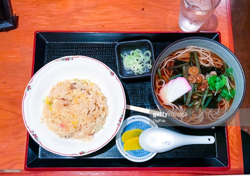 Lunch meal of yakimeshi (fried rice) and sansai soba (buckwheat noodles) : Stock Photo