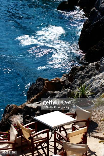 lunch on the rocks, hydra, greece - hydra stock photos and pictures