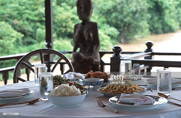 Lunch on the Wat Phu boat an old teak barge converted into a luxury cruising ship for tourists in Si Phan Don the Four Thousand Islands in the south...