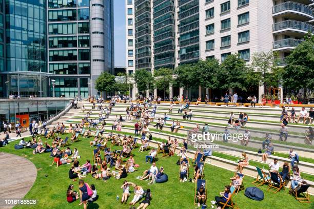 lunch time at sheldon square amphitheatre and office architecture in paddington, london - amphitheater stock photos and pictures