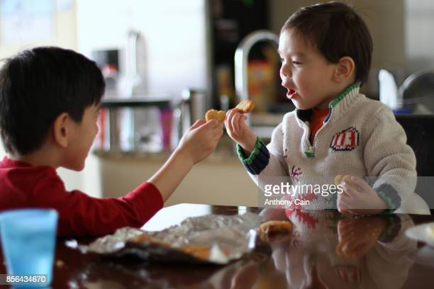 lunch time sharing with 2 brothers. - chicken nugget stock pictures, royalty-free photos & images