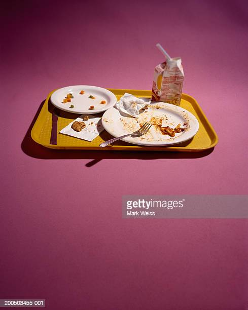 lunch tray with dirty dishes on pink background - drinks carton stock pictures, royalty-free photos & images