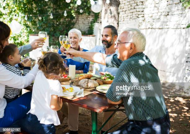 lunch with dearest people - family reunion stock pictures, royalty-free photos & images
