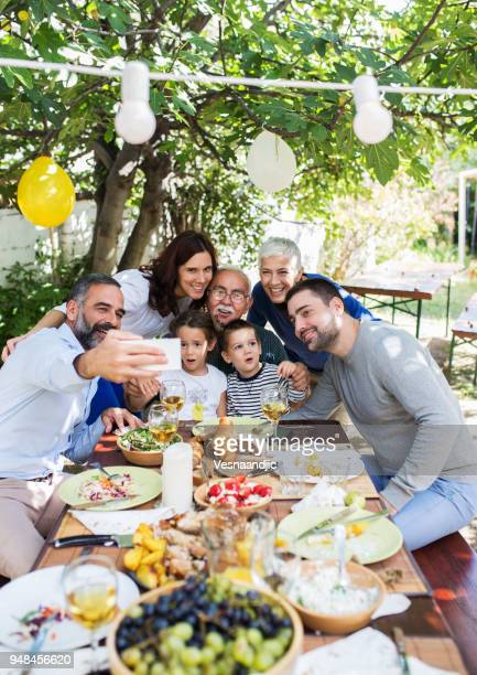 lunch with dearest people - easter stock pictures, royalty-free photos & images