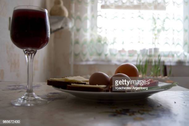 lunch with eggs, wine, and cheese sandwiches - argenberg stock pictures, royalty-free photos & images