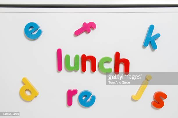 'Lunch' written with magnetic letters on a fridge
