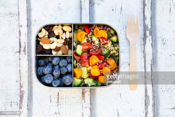 lunchbox with quinoa salad with tomato and cucumber, blue berry and trail mix - snack stock pictures, royalty-free photos & images