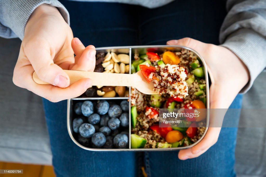 Lunchbox with quinoa salad with tomato and cucumber, blue berry and trail mix : Stock Photo