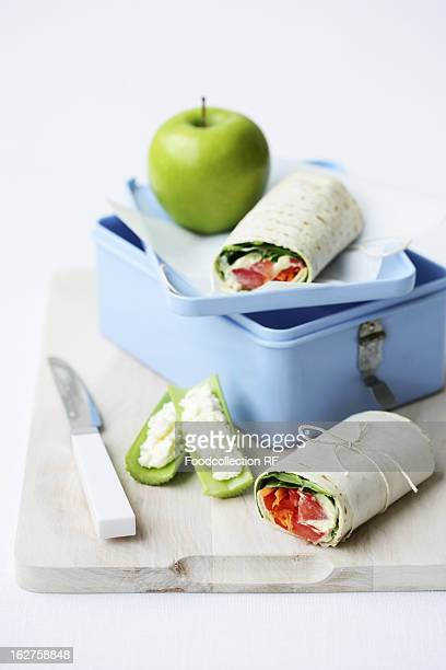 Lunchbox with wraps and apple