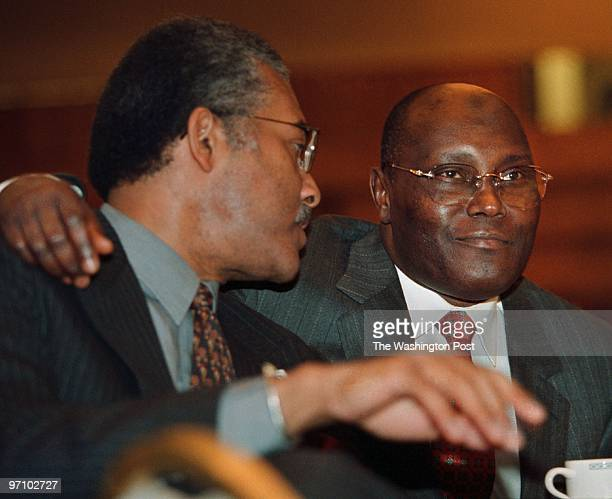 Luncheon HE Daniel arap Moi chair of common market for Eastern and southern Africa This is from left Lenoard Robinson President and CEO of the...