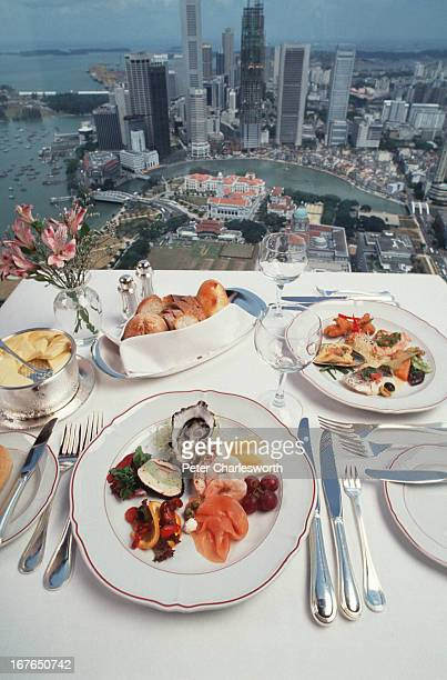 A lunchtime meal setting including a plate of seafood at the topfloor Compass Rose restaurant in the Westin Stamford Hotel This is lunch with a...